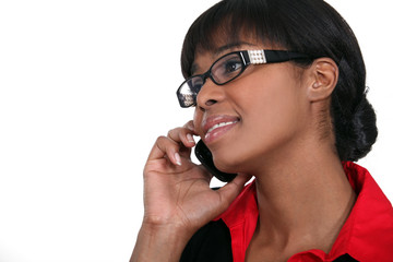 Businesswoman taking a call from client
