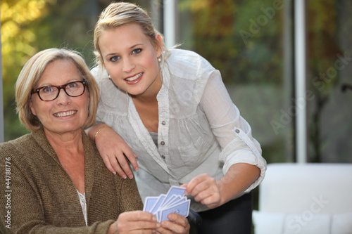 Granddaughter playing cards with Grandma