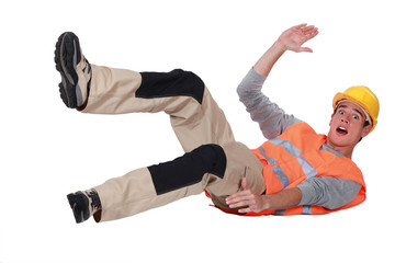 Construction worker falling over