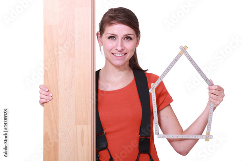 Woman stood with laminate flooring