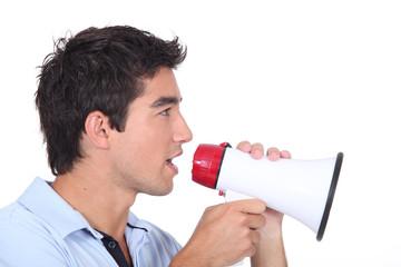 Man speaking into a megaphone