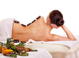 Woman getting spa lastone therapy outdoor. poster