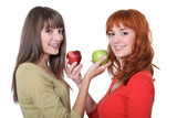 two women holding apples