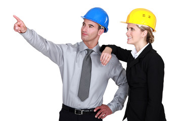 Colleagues in hard hats