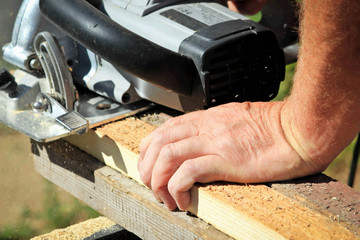 Man sawing board