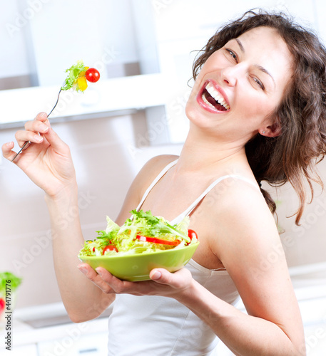 Diet. Healthy Young Woman Eating Vegetable Salad