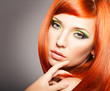 Beautiful Woman with long Red Hair and bright makeup