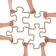 Hands holding rope forming puzzle pieces