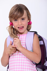 Young schoolgirl with a rucksack