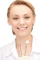 attractive female dentist with tools