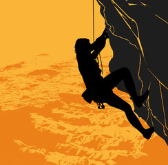 Rock climber on a sunset background