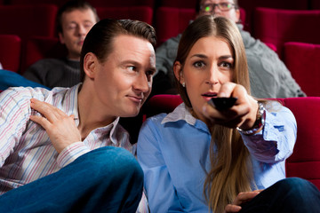Couple and other people in cinema