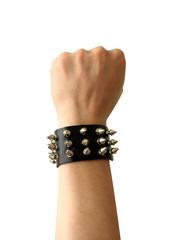Fist of rocker in leather bracelet.
