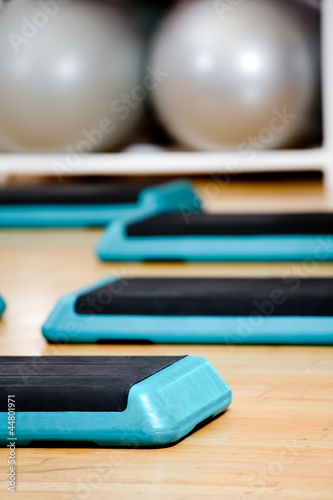 Step board and gym balls in aerobics class