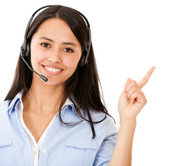 Woman with headset pointing