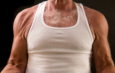 healthy aging: arms and shoulders of senior man exercising
