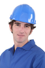 Man in blue overalls and hardhat