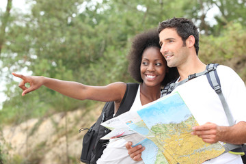 Couple reading map outdoors