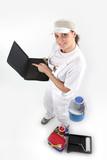 Female painter holding laptop