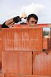 Mason adjusting brick wall