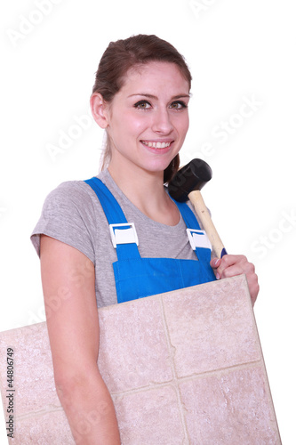 craftswoman carrying tiles