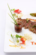 Beefsteak decorate with edible flowers, (Thai food Style)
