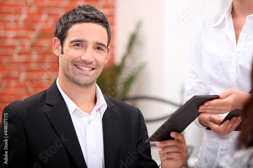 Man paying bill at restaurant