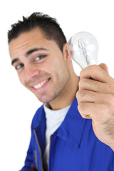 Smiling laborer holding light bulb