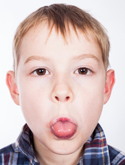 Boy showing a tongue