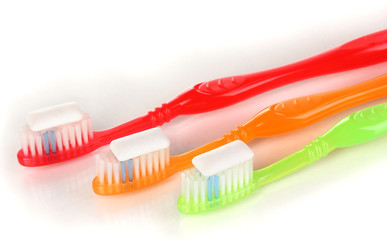 Toothbrushes and chewing gum isolated on white