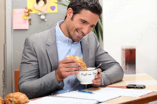 Man having breakfast at home