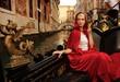 Beautiful woman in red cloak riding on gandola
