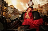 Beautiful woman in red cloak riding on gondola poster