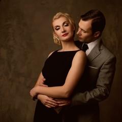 Retro couple on grey background