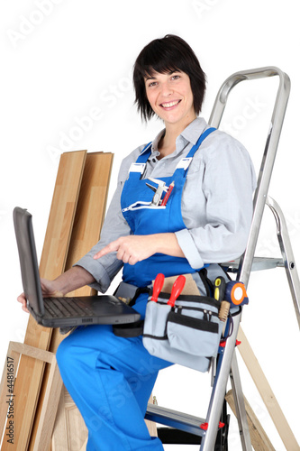 female carpenter with her laptop