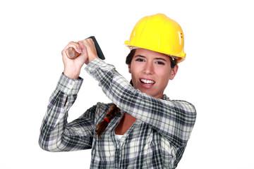 craftswoman striking with a hammer