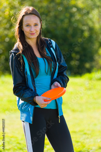 Woman and frisbee