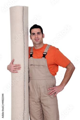 craftsman holding a carpet