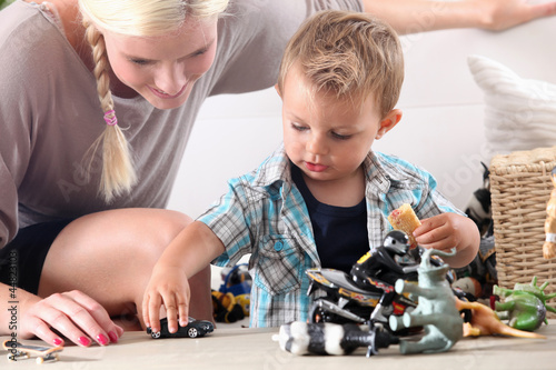 Poster Mother and child playing with toy cars