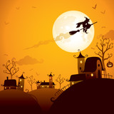 Witch flying above the houses in Halloween night
