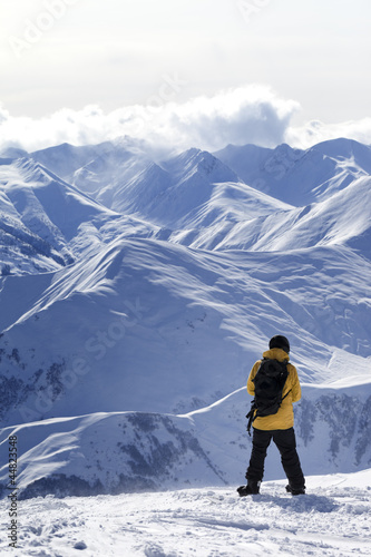 Snowboarder on top of mountain