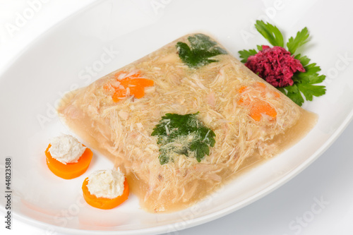 Jellied meat with boiled parsley, carrots and horseradish