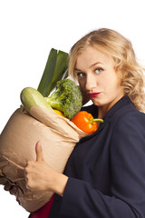 Attractive woman holding a bag of useful food