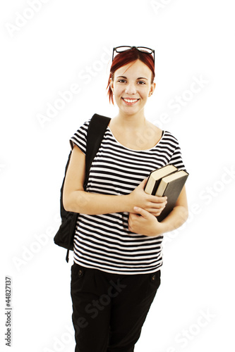 A smiling female student with a school bag holding a book
