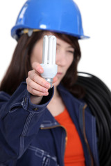 Electrician holding a compact fluorescent lamp