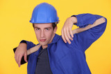 Young builder posing with sledge-hammer