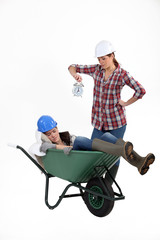 Woman snoozing in wheelbarrow