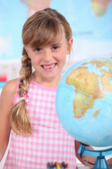 Girl at school with globe