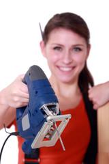 Female artisan holding jigsaw