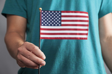 Man Holds Small American Flag